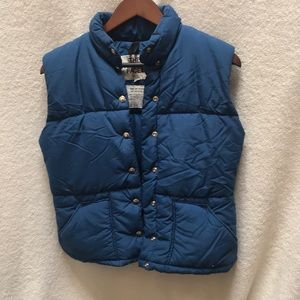 The North Face Blue puffer vest size medium